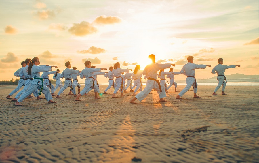 Kids karate class on the beach