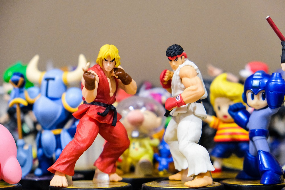 Toys from street fighter lined up on a desk
